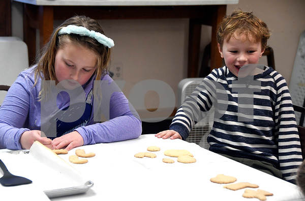 12/9/2017 Mike Orazzi | Staff Emma Porteus,9, and her brother Ramsey,5, with cookies during the Snowman Party held at the New Britain Youth Museum at Hungerford Park Saturday afternoon.