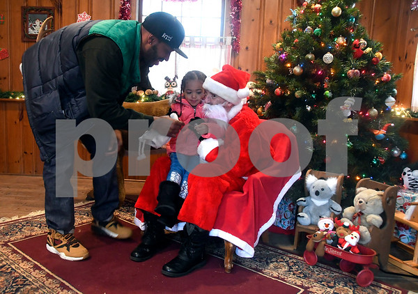12/10/2017 Mike Orazzi | Staff John Pettway and his daughter Kendal, 3 1/2, meet with Santa at the Pebble House during the Annual Santa's Farm Workshop held at Indian Rock Nature Preserve in Bristol Saturday morning.