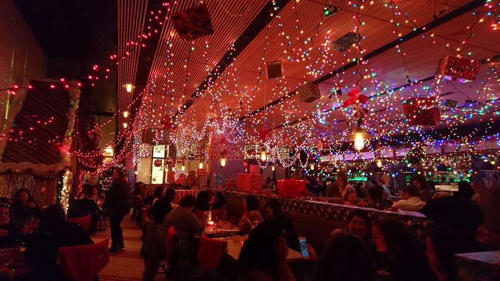 holiday lights cover a restaurant space