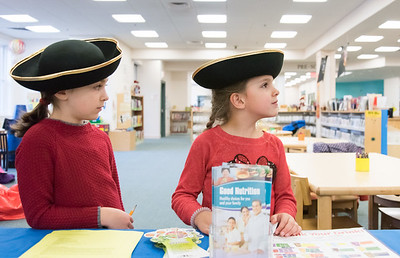 12/05/18  Wesley Bunnell | Staff  Bristol Library held Disney Day featuring Disney themed events for children.  Sisters Elizabeth Putelli, L age 7, and Andrea, age 6, take a moment to look over clues in their scavenger hunt.