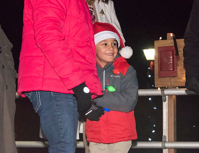 12/06/18  Wesley Bunnell | Staff  Plainville held a tree lighting ceremony on Thursday at Fire HQ featuring singing, refreshments and a visit from Santa with a chance to sit on his lap.  Evan Papastamatiou from Linden St. School watches the tree light after flipping the switch.