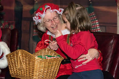 12/06/18  Wesley Bunnell | Staff  Plainville held a tree lighting ceremony on Thursday at Fire HQ featuring singing, refreshments and a visit from Santa with a chance to sit on his lap.  Kailyn Agudelo, age 6, receives a candy cane from Mrs. Clause.