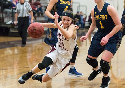 12/10/18  Wesley Bunnell | Staff  Bristol Central basketball vs Simsbury on the first game of the season on Monday night at Bristol Central High School. Kayla Beaulieu (22) is tripped up while driving baseline.