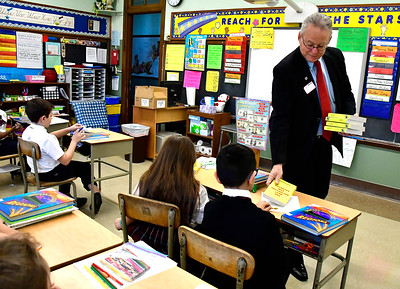 12/11/2018 Mike Orazzi | Staff Rotary Club of New Britain-Berlin's Mark Bernacki while handing out dictionaries to 3 grade students in Mr. Gary Kus' class at the Holy Cross School in New Britain Tuesday morning. Each year the rotary provides all city 3 grade students with dictionaries.