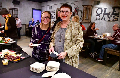 12/1/2018 Mike Orazzi | Staff Laura and Penny D'Angelo during a sneak-peek event Saturday to help raise funds for the Southington High School All Knight Grad Party at the Que Whiskey Kitchen on Queen Street.