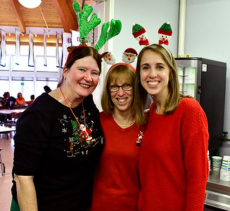 12/01/2018 Mike Orazzi | Staff Volunteers Maryellen Holden, and Chris Bracken and her daughter Emily during the 25th Annual Breakfast with Santa at the Giamatti Little League Center Saturday in Bristol.