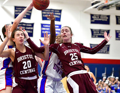 12/13/2018 Mike Orazzi | Staff Bristol Central's Gwen Torreso (20) and Ashley Watson (25) during Thursday night's basketball game at PHS.