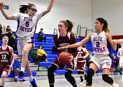 12/13/2018 Mike Orazzi | Staff Plainville High School's Jaida Vasquez (5) and Samantha Lozefski (2) with Bristol Central's Ashley Watson (25) during Thursday night's basketball game with at PHS.