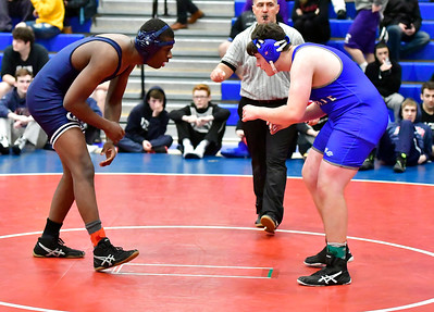 12/15/2018 Mike Orazzi | Staff Plainville's Adam Buckley and Avon's Amir Johnson in a 195 match during the Plainville Invitational Wrestling Tournament Saturday.