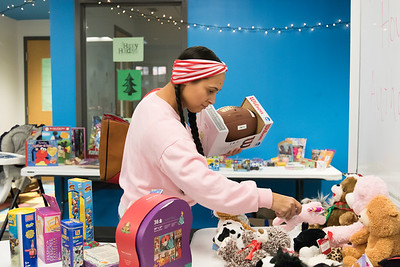12/17/18  Wesley Bunnell | Staff  Glenda Negron picks out toys for ages two, three and twelve year old children at the New Britain Housing Authority's 9th annual toy donation on Monday afternoon.