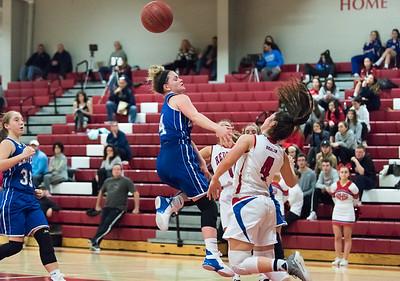12/17/18  Wesley Bunnell | Staff  Berlin basketball vs Bristol Eastern at Berlin High School on Monday evening. Julia Gettings (4) is fouled by Lyzi Litwinko (4).