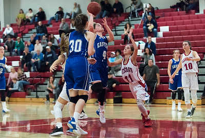 12/17/18  Wesley Bunnell | Staff  Berlin basketball vs Bristol Eastern at Berlin High School on Monday evening. Maura McGuire (30) watches as Julia Gettings (4)shoots over Arianna Hender (11).