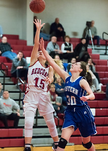 12/17/18  Wesley Bunnell | Staff  Berlin basketball vs Bristol Eastern at Berlin High School on Monday evening. Carly Grega (15) with a shot attempt on the fast break over Maura McGuire (30).