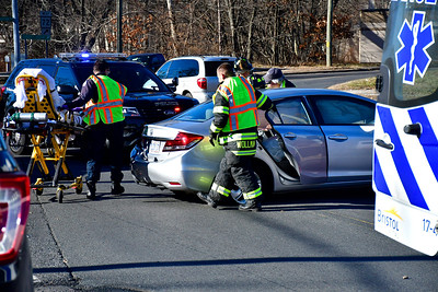 12/18/2018 Mike Orazzi | Staff The scene of a two-car crash at the intersection of Riverside Avenue and Downs Street Tuesday afternoon. One was transported from the scene.
