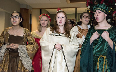 12/18/18  Wesley Bunnell | Staff  The New Britain High School Madrigal Singers visited 1 Liberty Square on Tuesday afternoon to perform. Ariana Soto, L, Claire Palin & Nick Giantonio.