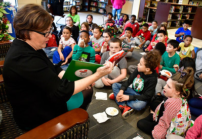 12/20/2018 Mike Orazzi | Staff Bristol Mayor Ellen Zoppo-Sassu reads to 3rd grade children at the West Bristol School during their Grinchmas, a month-long celebration of literacy events and community services on Thursday afternoon.