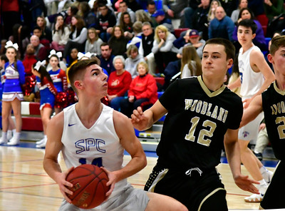 12/20/2018 Mike Orazzi | Staff St. Paul Catholic High School's Kevin Ashworth (14) during Thursday night's boys basketball game with Woodland in Bristol.