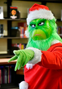 12/20/2018 Mike Orazzi | Staff The Grinch greets children at the West Bristol School during their Grinchmas, a month-long celebration of literacy events and community services on Thursday afternoon.