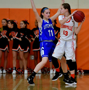 12/21/2018 Mike Orazzi | Staff Terryville's Alivia Cote (13) and Litchfield's Mackenzie Schweter (11) during Friday night's girls basketball game in Plymouth.