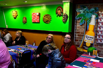 12/21/2018 Mike Orazzi | Staff A gathering at the El Paso Mexican Restaurant on East Main Street in Plainville in support of their father Isaias Iriarte who is currently under a deportation order and being held at the Bristol County Sheriff's Department in Massachusetts.