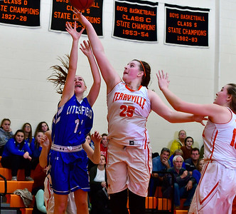 12/21/2018 Mike Orazzi | Staff Terryville's Lauren Jacobs (25) and Litchfield's Mackenzie Schweter (11) during Friday night's girls basketball game  in Plymouth.