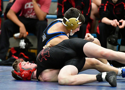 12/22/2018 Mike Orazzi | Staff Bristol Eastern's Tommy Nichols and Northwestern's Hunter Sanden in a 132 match at Eastern in Bristol Saturday morning.