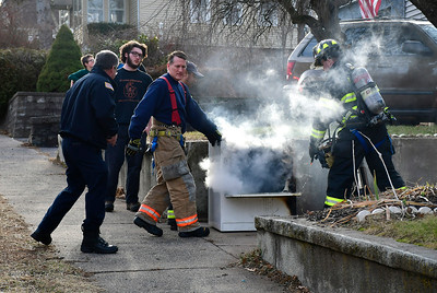12/27/2018 Mike Orazzi | Staff Members of the Bristol Fire Department extinguish a dyer fire at a home on Divinity Street Thursday afternoon. No one was injured and the fire was extinguished without extension to the home.