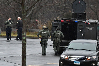 12/28/2018 Mike Orazzi | Staff  Area poice on scene at the Connecticut Commons in Plainville after a man fire two shots into a door behind a Lowes hardware store and is currently surrouned by a police SWAT team.