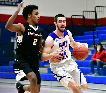 12/28/2018 Mike Orazzi | Staff University's Joel Soto (2) and Plainville's Brady Callahan (22) during the Rybczyk Holiday Tournament at Plainville Friday.