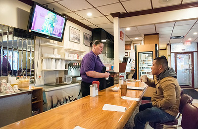 12/31/18  Wesley Bunnell | Staff  Waitress Rachel Sundell takes Brener Alvarado's order, who is visiting relatives in the area from Washington, on Monday afternoon at the New Britain Diner.