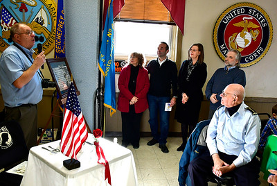 12/7/2018 Mike Orazzi | Staff Post 2 Historian Neal Supranovich presents makes a presentation to the members of the Riccio family during a Pearl Harbor ceremony in Bristol Friday morning.