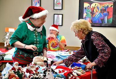 12/7/2018 Mike Orazzi | Staff Nancy Durkin helps Anne Egan find crafts during the New Britain Senior Center's annual Holiday Bazaar Craft Fair on Friday.