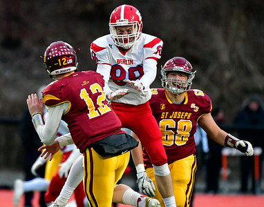 12/8/2018 Mike Orazzi | Staff St. Joseph's David Summers (12)  and Berlin's Danny Lynch (88) during Saturday's Class M Football State Football Championship  at Shelton High School. St. Joseph won St. Joseph 70 to 18.