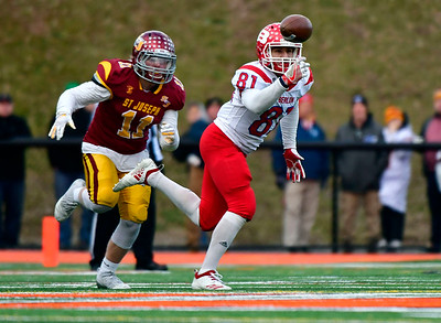 12/8/2018 Mike Orazzi | Staff Berlin's Giancarlo Tufano (81) hauls in a pass during Saturday's Class M Football State Football Championship with St. Joesph at Shelton High School. St. Joseph won St. Joseph 70 to 18.
