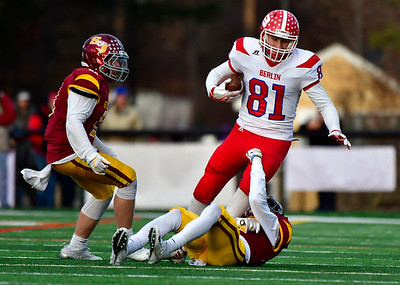 12/8/2018 Mike Orazzi | Staff St. Joseph's Myles Hall (27) and Berlin's Giancarlo Tufano (81) during Saturday's Class M Football State Football Championship  at Shelton High School. St. Joseph won St. Joseph 70 to 18.