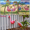 A couple of literally legless flamingos, seen early this morning propped up against a backstreet fence, offer a timely reminder of the difference between expectation and reality. (Art work: Doreen Tracey)