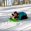 Emily Greuel sledding with her chickens just north of Effingham in the Green Creek area.<br /> Submitted by Karan Greuel