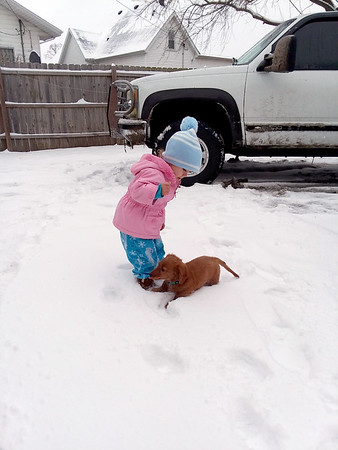 My granddaughter and her puppy. She loves her Scooby.