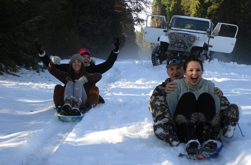 Doubling up.  Look at them grins.  Sledding turns anyone into an 8 year old.