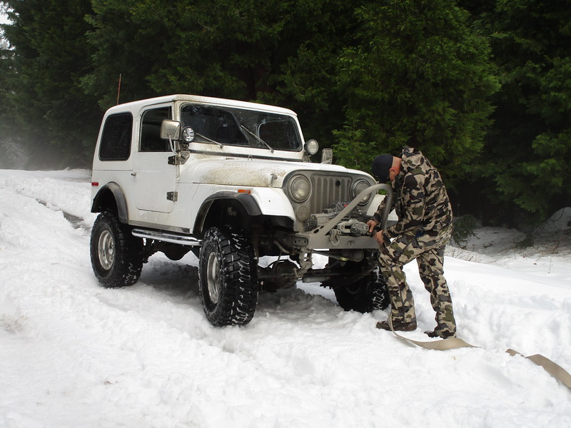 Don connects a tow strap between his Jeep and my tow hitch.