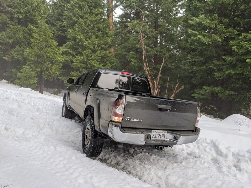 Then I pretty much did the same thing; slid off the road, got in a rut, and couldn't get traction to get back on the road.  At this point, we had been on an unplowed road for 3 miles or so and we were only gaining elevation, so the snow wasn't going to get better.  We decided to turn around.