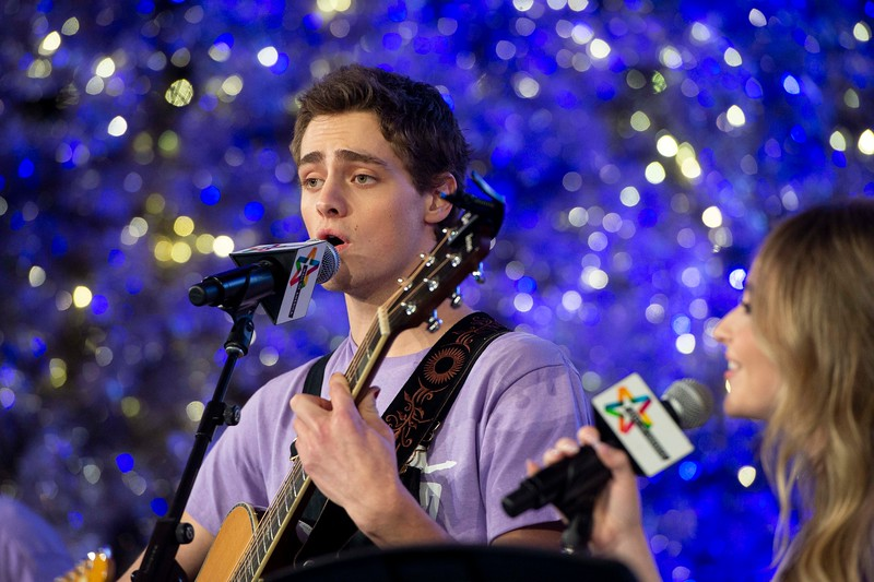 "Fin Argus, who portrays Zach Sobiech in the upcoming film, ""Clouds,"" sings ""Let it snow"" during the annual Clouds' Choir for a Cause event at the Mall of America on Friday, Dec. 13, 2019. (Jack Rodgers / Pioneer Press)"