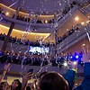 Participants reach for streamers following their performance during the annual Clouds' Choir for a Cause event at the Mall of America on Friday, Jan. 13, 2019. (Jack Rodgers / Pioneer Press)