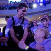 "Fin Argus, who portrays Zach Sobiech in the upcoming film, ""Clouds,"" embraces his grandmother, Rosemay Argus, before performing onstage during the annual Clouds' Choir for a Cause event at the Mall of America on Friday, Jan. 13, 2019. (Jack Rodgers / Pioneer Press)"