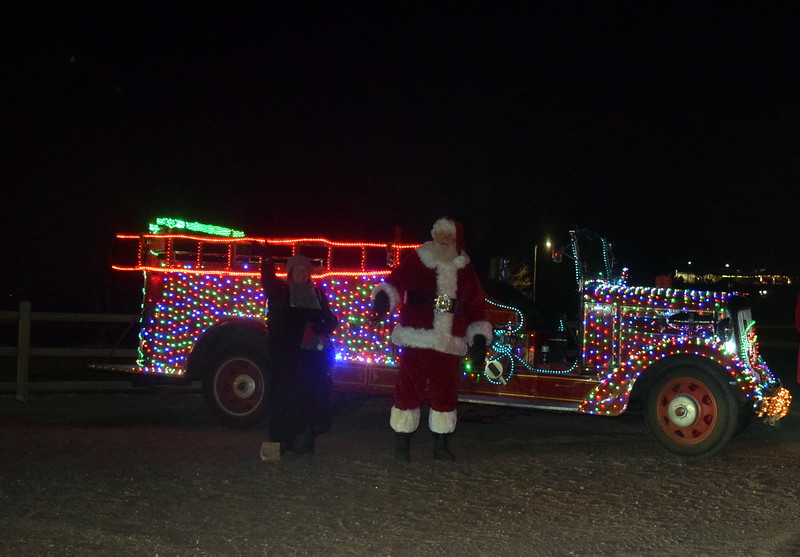 Santa Clause and his helpers gave out bags of candy to children as they exited the Logan County Chamber of Commerce's drive through Parade of Lights at Pioneer Park Thursday, Dec. 3, 2020.