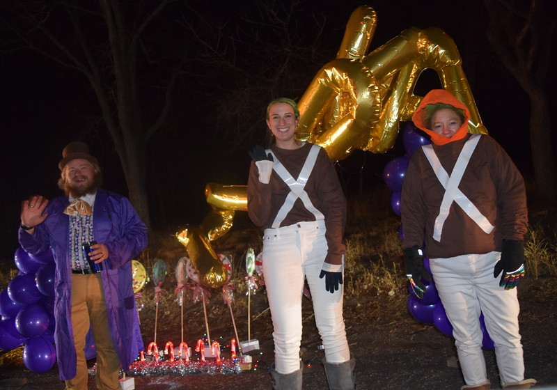 Willy Wonka and a couple of Oompa Loompa's wave to passersby from the Step Out For Kids' float at the Willy Wonka and The Christmas Factory themed drive through Parade of Lights presented by the Logan County Chamber of Commerce Thursday, Dec. 3, 2020, at Pioneer Park.