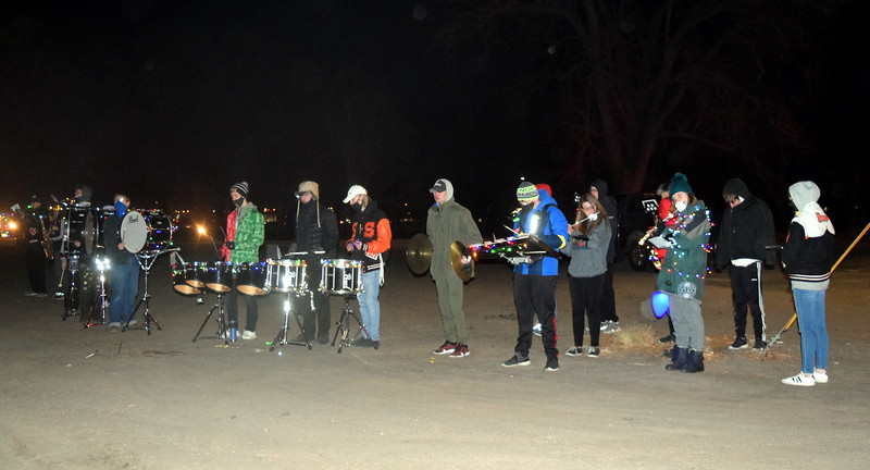 Sterling High School's marching band performs at the Willy Wonka and The Christmas Factory themed drive through Parade of Lights presented by the Logan County Chamber of Commerce Thursday, Dec. 3, 2020, at Pioneer Park.