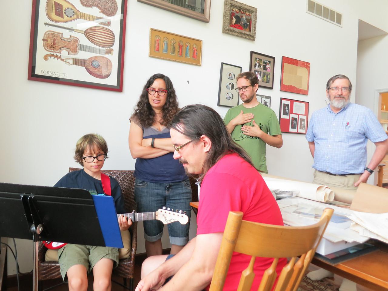 <big>Here, Grandpa surveys with great satisfaction his children & grandson making music together.</big>