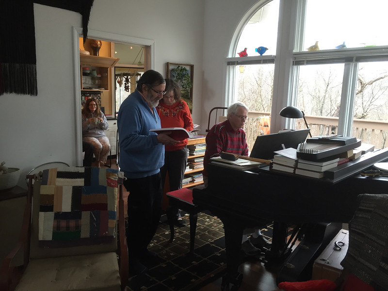 He's making music here with family. His sister Katherine is next to Eliot; her husband Brian is at the piano; his sister Alison is in the kitchen listening, with a cup of tea. Brian's research took him to IU for a short visit & the sisters decided to come along. This was an unusual and precious visit.