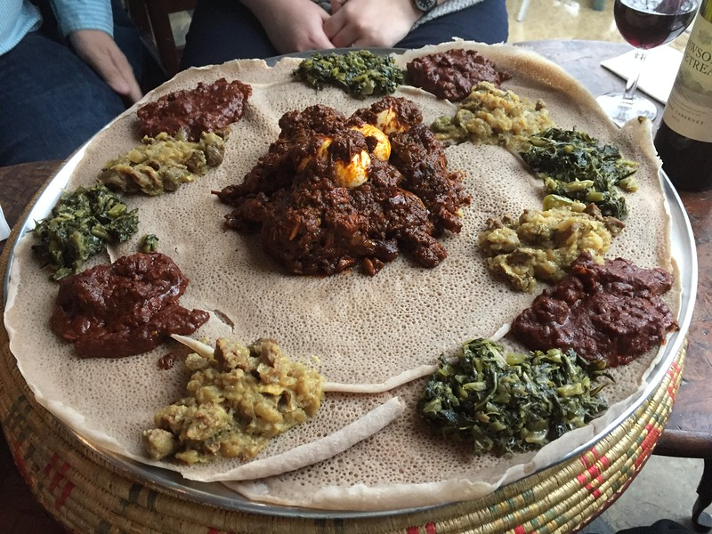 We don't generally put food pictures in our holiday album, but we decided to make an exception for the Deluxe Injera Dinner for Four. This is the BEFORE shot.